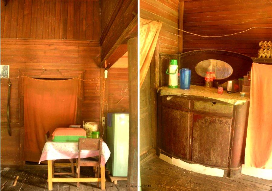 meja makan dan lemari makan di sudut dekat pintu masuk