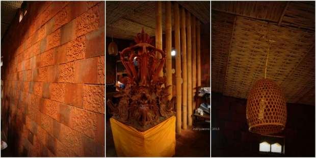 dinding bermotif, patung dan kap lampu pengumpul terang