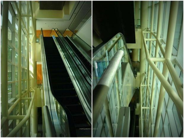 sisi eskalator dengan jendela curtain glass dan back mullion